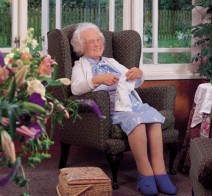 Gladys using the webcam at Boars Tye Residential Care Home